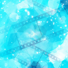 film strip on glowing blue background
