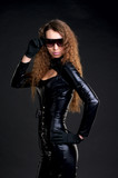 Sexy woman in skintight latex and sunglasses