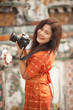 smiling asian woman taking pictures