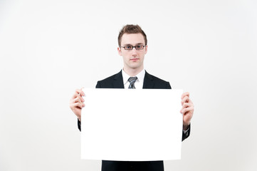 young businessman with blank whiteboard