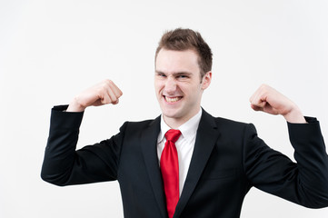 young businessman showing his muscle