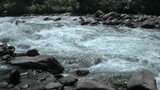 alpine stream between stones (with sound)