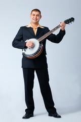 Man Is Playing on Banjo.