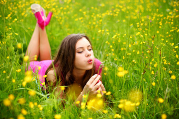 woman blow on dandelion