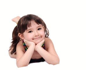 smiling little girl in bathing suit with hands on chin. isolated