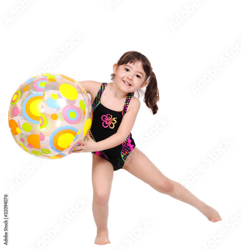 adorabe little girl in swimsuit playing with beach ball isolated