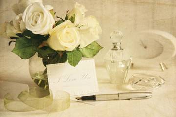 Love note with white roses and pen