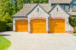 Fragment of a luxury house with triple garage door