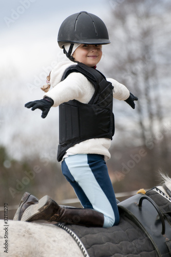 Horse riding - little girl stunt riding