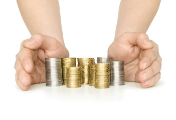 stacks coins between hands isolated on white