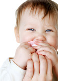 bright closeup portrait of adorable baby with nipple