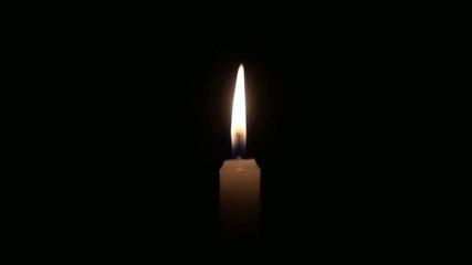Isolated burning candle