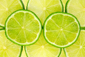 close-up image of fresh green lemon slices .
