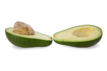 two halves of avocado fruit isolated on white.