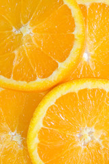 close-up image of fresh orange fruits slices.