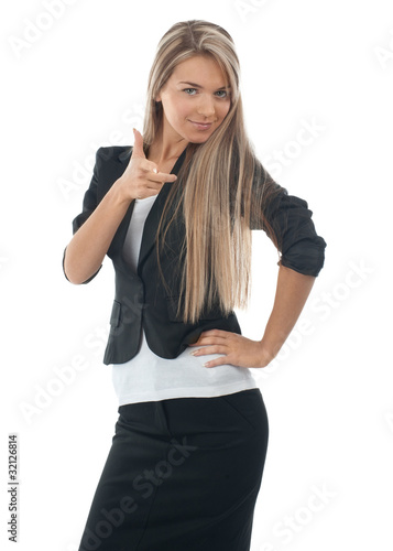 Businesswoman pointing at viewer
