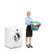 Woman standing next to a washing machine