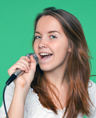 portrait of beautiful singer girl with microphone in hand