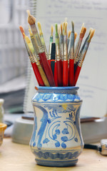 Pot with paintbrushes