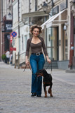 The woman walks with a dog