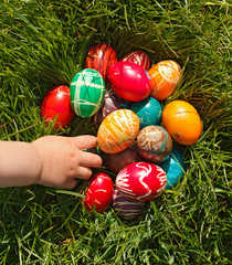 Hand taking Easter egg
