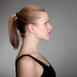 Profile of a woman with a pigtail