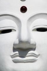 close up of white  buddha face