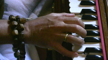 Playing harmonium instrument