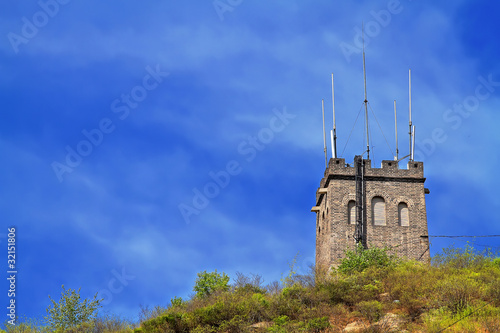 Tower on a moutain under the blue sky