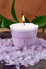 purple candle and sea salt spa concept