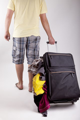 man walking with a suitcase and loosing the luggage.