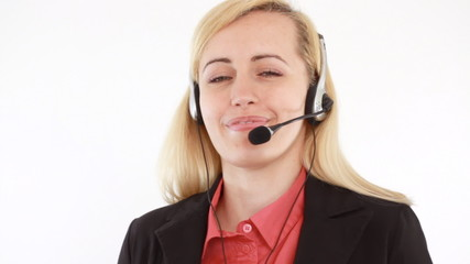 Attractive helpdesk consultant talking on headset, isolated
