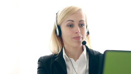 Attractive helpdesk consultant talking on headset