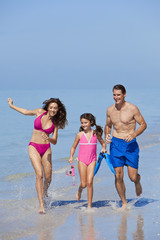 Mother, Father & Daughter Child Family Running on Beach