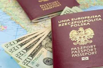 Passports and money over map background