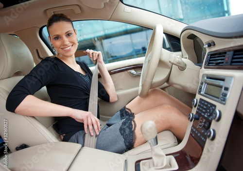 woman and safety belt in the car