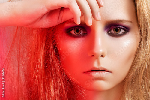 Female model face with dark fashion smoky-eye make-up