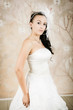 beautiful bride stands in an elegant white dress