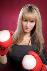 sexy beautiful blond woman in boxing gloves