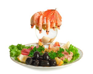 Appetizer of shrimp, fish, meats, olives and fresh vegetables