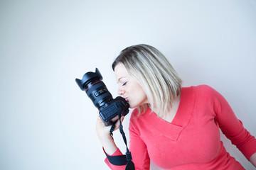 pretty female photographer with her digital camera