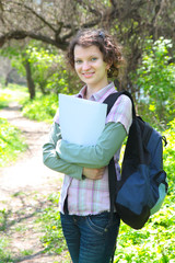 Female Teenage Student In summer Park