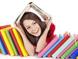 Girl with stack color book.