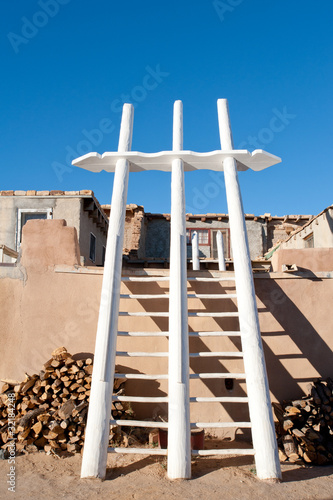 Traditional white ladders in Acoma Pueblo, NM