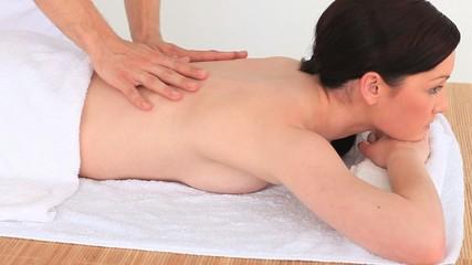 Dark-haired woman having a massage