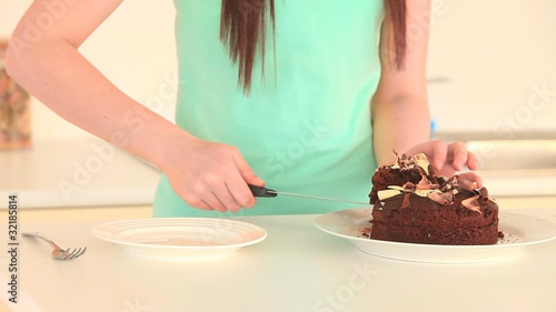 Woman taking a slice of cake
