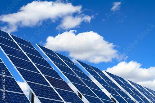solar panels over blue sky - 32186874