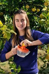 Girl making natural lemonade