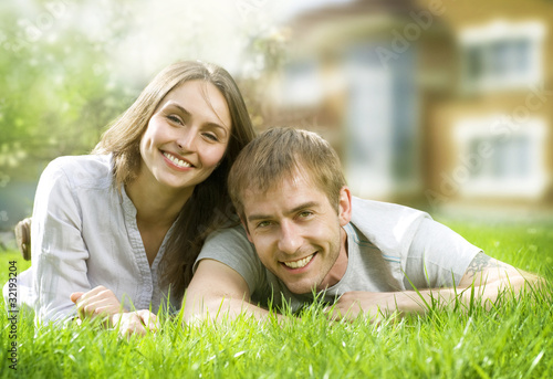 Happy Couple near their Home. Smiling Family outdoors.
