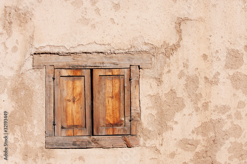 Beautiful old window in hisorical adobe, Taos, NM